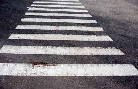 Zebra crosswalk on the road for safety when people walking cross the street. Crosswalk. Stock Photo