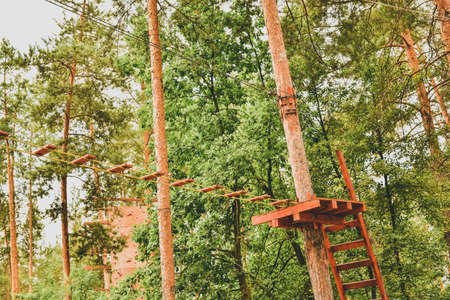Rope town. Active family vacation in the open air. Elements of a rope town in the park. Rope town in the forest