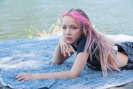 cute child girl portrait . Outdoor portrait of cute little girl in summer day. Portrait of a little girl with pink hair. Child 9-10 years old. Teenager