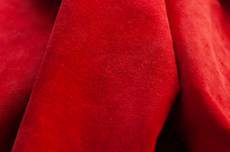 Red matte background of suede fabric, closeup. Velvet texture of seamless leather. Felt material 版權商用圖片 - 159605249