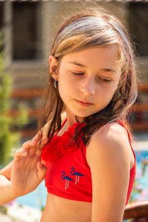 Beautiful girls in summer time. Girl in a swimsuit on vacation. Teenager girl 10 years old