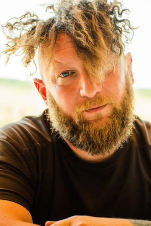 Close up portrait of fashionable redhead hipster man with fuzzy beard. Redhead man