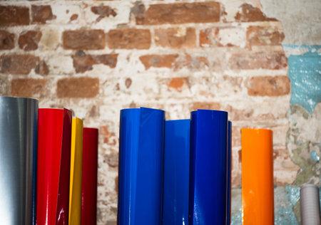 colored vinyl car wrapping or plotter cutting sticker foil film rolls. Film in rolls for advertising Zdjęcie Seryjne