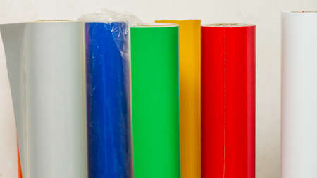 colored vinyl car wrapping or plotter cutting sticker foil film rolls. Film in rolls for advertising Archivio Fotografico