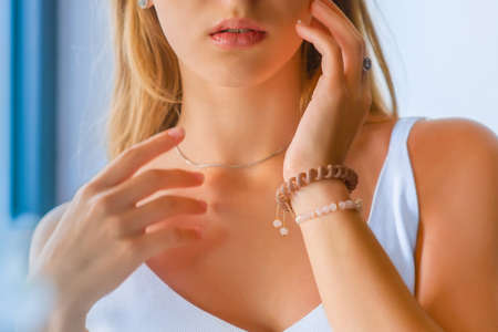 close-up portrait of beautiful girl's lower part of face and manicured fingers. Girl's lips and hands