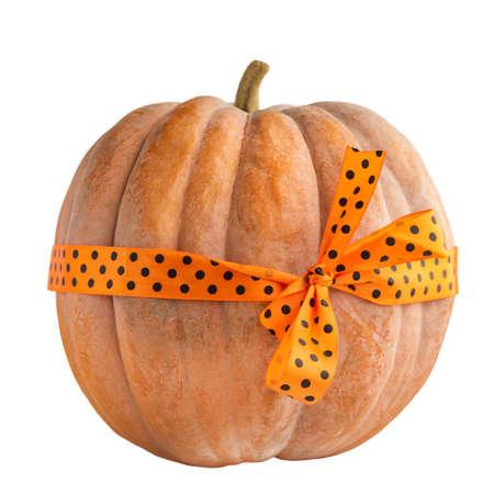 Selective focus of halloween pumpkin. Halloween pumpkin with orange ribbon.