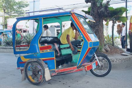 Motor tricycle are the both cheap common means transportation and symbol of Philippine culture. Standard-Bild