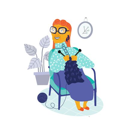 Cheerful woman senior adult kniting concept, sitting on cozy sofa at home, elderly generation hobby activity Imagens