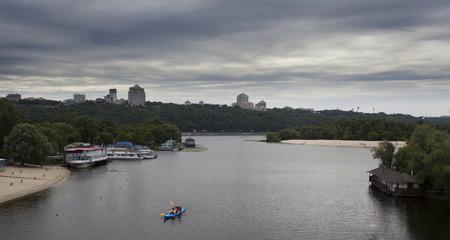 the dnieper: View of Dnieper river in Kiev, canoe, Ukraine Editorial