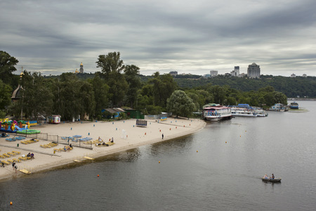 dnepr: Kiev beach, Dnepr and boats on river. Before the thunderstorm.