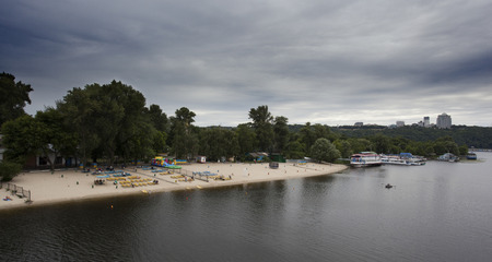dnepr: Kiev Dnepr and boats on river. Before the thunderstorm.