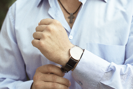 french cuffs: the man in the light blue shirt with a luxary watch