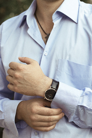 french cuffs: sexy man in luxury blue shirt and rist watch
