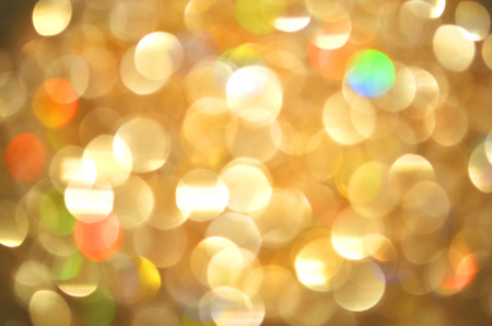 Bokeh gold colour abstract background. Glittering stars on golden Christmas background.