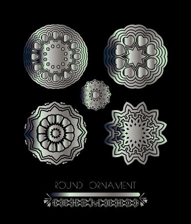 metallic  sun: Silver circular ornament on black background. Silver mandala