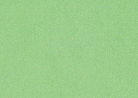 Abstract background with green texture.  Velvet fabric full frame closeup.
