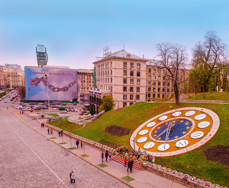 KIEV, UKRAINE - OCTOBER 29, 2017:  Square of Independence in autumn. Maidan Nezalezhnosti  located on Khreshchatyk Street at weekend. Floral clock in Kiev