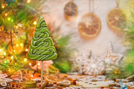 Christmas colorful tree made of sugar candie.  Empty place for photo or text. Candy Christmas green tree Stock Photo