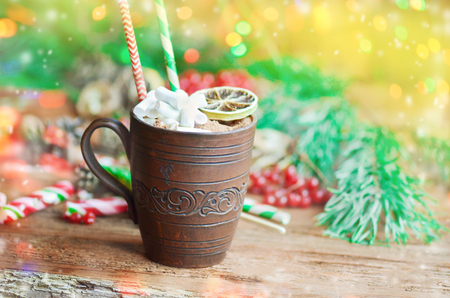 Cup of cocoa on a festive background. Cocoa  in  brown clay cup close