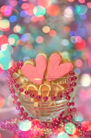 Heart Shaped Cookies With Pink Frosting On Abstract Blurry Bokeh