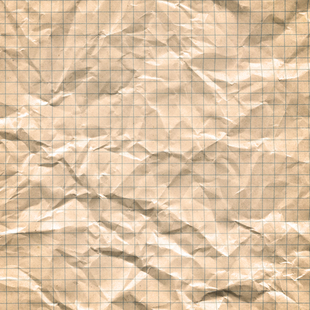 Vintage discolored dirty yellow gold paper grid sheet background. Old yellowing paper.