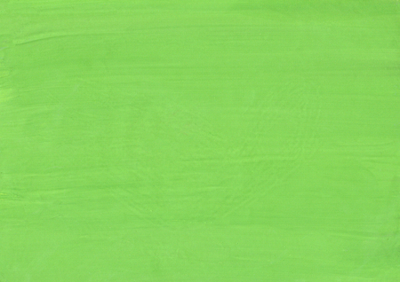 Green gouache  paint on paper background. Green paper texture. View with copy space