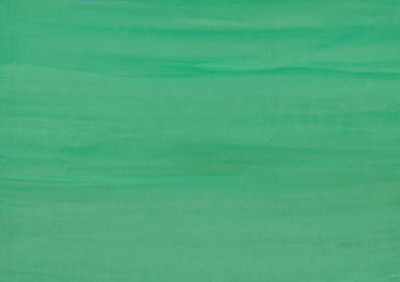 Green gouache  paint on paper background. Green paper texture.