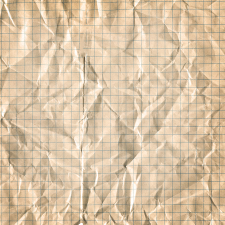 Squared paper sheet background. Yellow gold paper grid sheet background. Old yellowing paper.