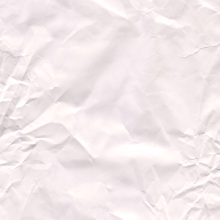 Wrinkled crumpled paper texture or background.  Texture of crumpled paper.  White paper sheet. Copy space for your commercial design Imagens