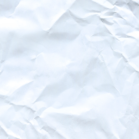 White crumpled paper for background. Empty parchment sheet