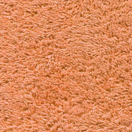 Texture of orange bath towel. Orange towel background.