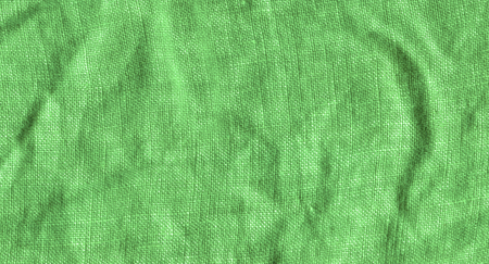 Green fabric surface for background. Green linen texture. Green flaxen background