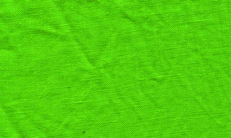 Green fabric surface for background. Green linen texture. Green flaxen background