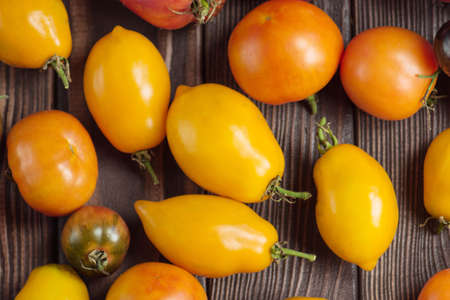 Locally grown and sustainably harvested. Organic industry and eco farming. Assorted tomatoes  background