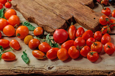 Mix tomatoes background. Several varieties of tomatoes on summer day. Different kind assorted colorful tomatoes. Stock Photo