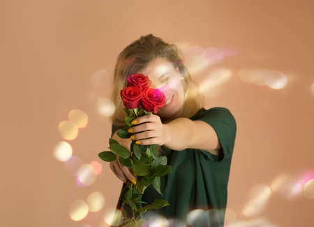 Girl with bouquet of red roses. Spring bouquet of red roses in womans hands on light beige background