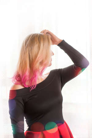 Model on pink background. Party time of stylish women. Romantic portrait of attractive woman with pink hairstyle