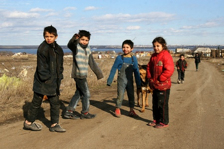 Group of children-homeless  on the bank of estuary in the Odessa steppe in the summer