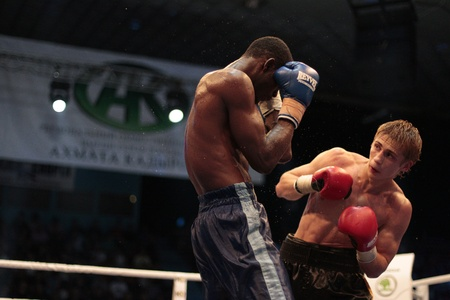 ODESSA, UKRAINE - July 30: WBC belt holder of the champion in junior middleweight champion  Alexander Spirko (Ukraine) strikes a blow against Selemani Said (Tanzania) during the World Cup in the junior middleweight title on the IBO version of the July 30  Redakční