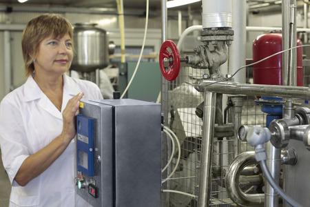 worker on a modern milk factory Standard-Bild