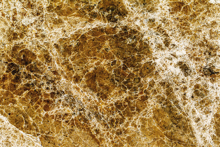 beautiful old yellow-brown decorative stone marble abstract cracks and stains on the surface as natural background photo