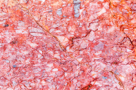 beautiful old reddish-brown pink decorative stone marble abstract cracks and stains on the surface as natural background photo