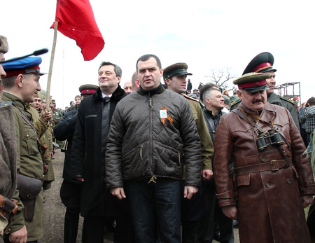 coup: ODESSA, UKRAINE - AUGUST 10: Interior Minister ( Police ) Ukraine Vitaliy Zakharchenko after coup obvlen criminal. On the reconstruction of the events of World War II , August 10, 2011 in Odessa , Ukraine
