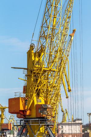 ODESSA, UKRAINE - APRIL 15: industrial large sea cargo cranes in the dock harbor of Odessa sea trading port cargo loading marine vessel in the Odessa seaport cargo container terminal, April 15, 2014 Odessa, Ukraine