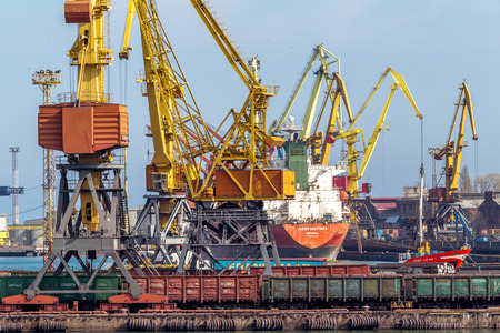 supposedly: ODESSA, UKRAINE - APRIL 15: industrial large sea cargo cranes in the dock harbor of Odessa sea trading port cargo loading marine vessel in the Odessa seaport cargo container terminal, April 15, 2014 Odessa, Ukraine