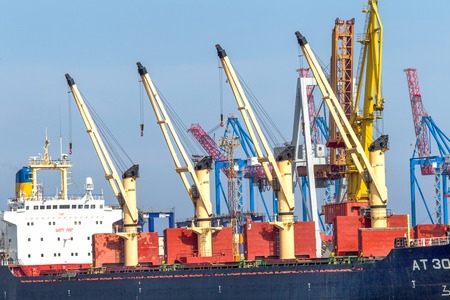 supposedly: ODESSA, UKRAINE - APRIL 15: maritime cargo ship moored in the harbor of Odessa sea port . Loading and unloading are carried out works of Ukrainian industrial goods, April 15, 2014 Odessa, Ukraine