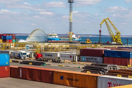 allegedly: ODESSA, UKRAINE - APRIL 16: Odessa sea cargo port. Container terminal . Dredging the harbor fairway , April 16, 2014 Odessa, Ukraine
