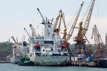 allegedly: ODESSA, UKRAINE - APRIL 10  maritime cargo ship is under loading cranes Ukrainian industrial goods in the harbor seaport, April 10, 2014 Odessa, Ukraine