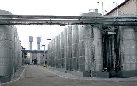 Large aluminum drums tanks and pipelines modern plant for the production of wine food industry.  photo