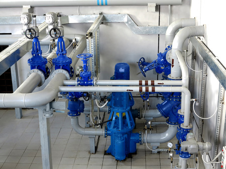 Water pumping station, industrial interior and pipes. Water system valves, electronic motor control water supply Imagens